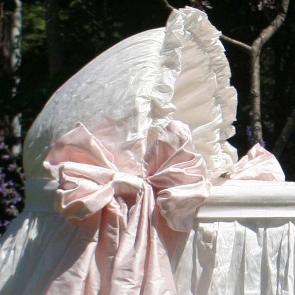 close up of jada bassinet ruffled hood showing blush pink side bow