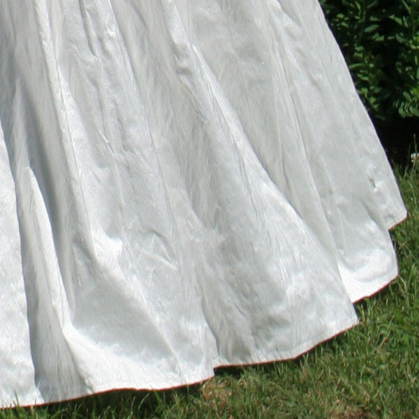 close up of bottom of jada bassinet silk skirt in white