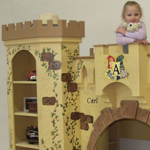 close up of child standing at top of elijah castle bunk bed