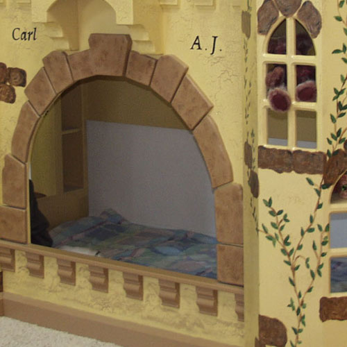 close up of botton twin bunk showing arched stone entrance of elijah castle bunk bed