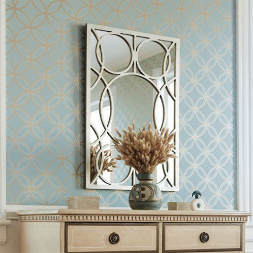 chloe wallpaper in metallic on slate shows circle pattern in gold on blue background