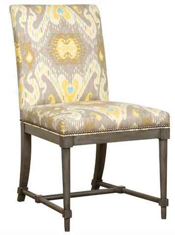 marley side chair shown in gray finish with nail heads with taupe, yellow and aqua fabric