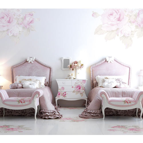 two makenna upholstered rose twin beds shown in bedroom with floral painted night table in between with floral bench seats shown at tend of beds.  Bed is accented with white bow on headboard.