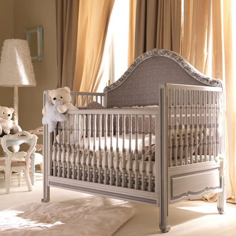 natalya crib shown in antique white and silver with upholstery in gray linen shown in neutral nursery