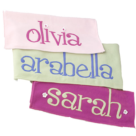 "arabella personalized blankets shown in pale pink with ""olivia"" , green with ""arabella"" and  fuchsia with ""sarah"""