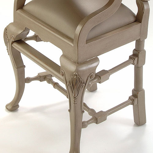 distressed gray high chair showing close up of handcarved leg