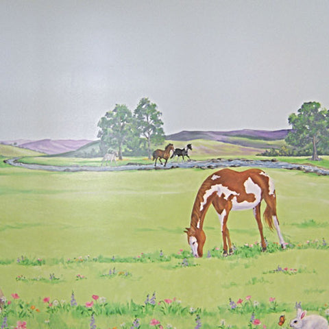 custom horse mural showing brown and white horse up close while brown and black horse run in the field further away