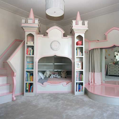 rosebud castle bed in pink and white shown with stairs on the left bed at the bottom with stage to the right
