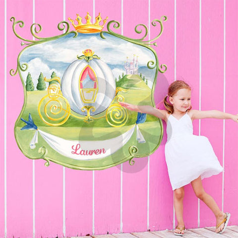miss princess coach wall decal features a coach with crown at top and personalized name below, girl is standing with it in her room with a pink striped wall