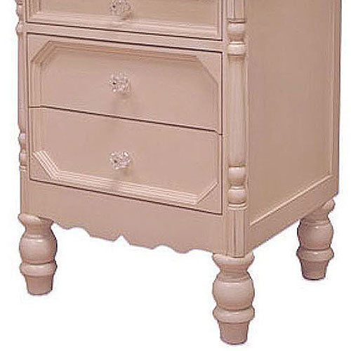 close up of bottom of night stand shown in ballet pink showing glass knobs and turned feet