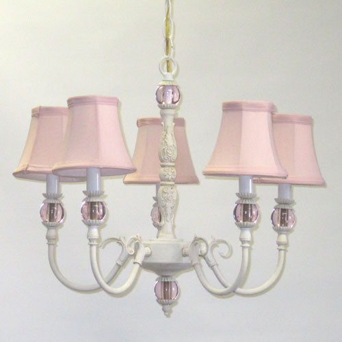 greta chandelier shown with a white base with five lights and accented with pink glass balls and pink shades