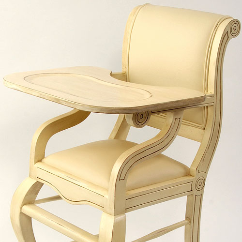 close up of sleigh highchair shown in distressed ivory with ivory vinyl seat and back