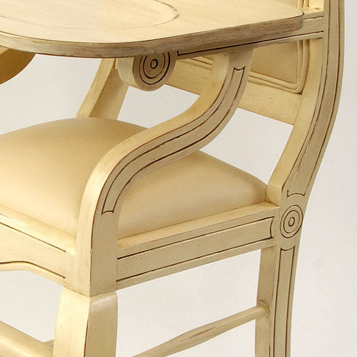close up of highchair in distressed ivory tray and seat