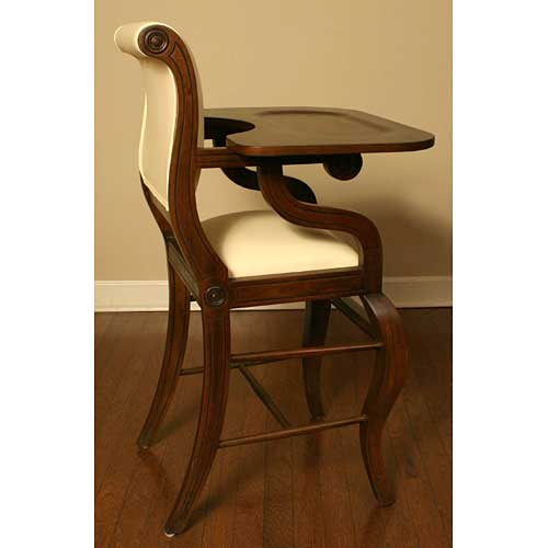 side profile of sleigh french walnut highchair with ivory seat and back