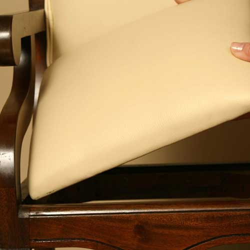 close up of sleigh highchair showing that ivory seat is removable for cleaning