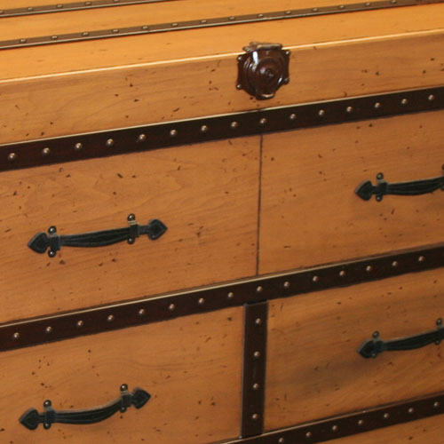 close up of steamboat hardware on willie trunk dresser