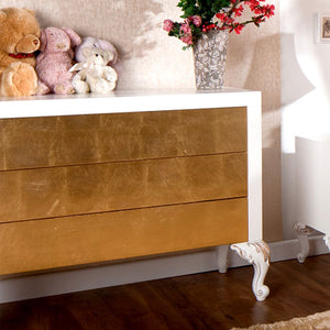 chelsea three drawer dresser in white with gold leaf drawer fronts and hand carved feet