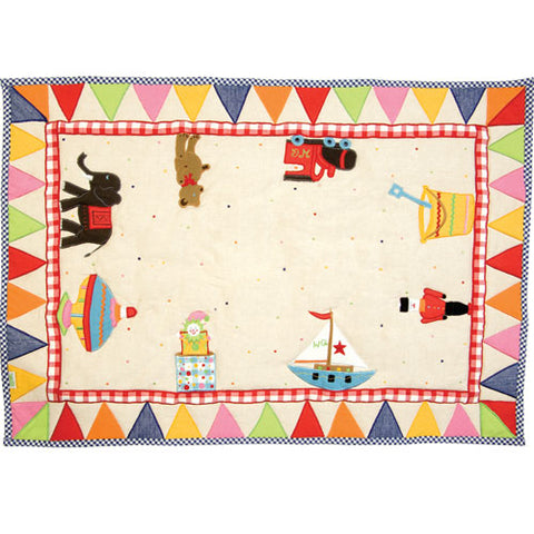novelty floor quilt shown with colorful flag border with novelty toys shown inside border