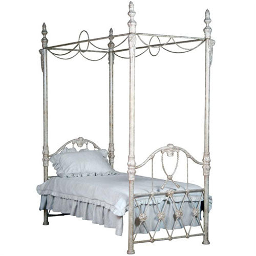 jefferson twin canopy bed is shown with neutral bedding in an off white finish with a swooping iron design that includes cherub faces