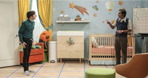 altman crib shown in nursery with bright colors as well as coordinating changing table