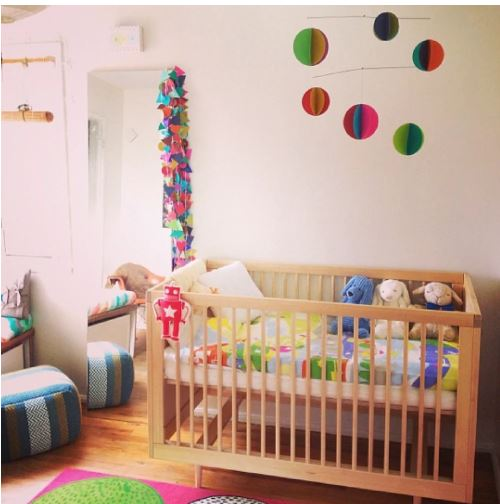 altman crib shown in vibrant nursery in birch finish
