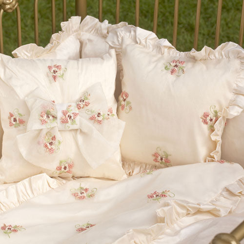 close up of basil bedding accent pillow options with ruffle trim and gift bow