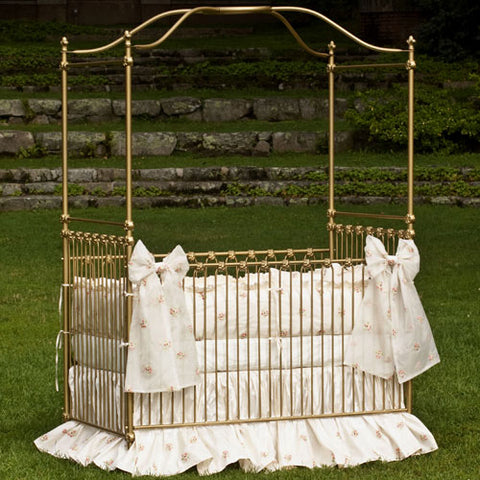 basil baby bedding shown with blossom silk organza in buttercream on gold canopy crib outdoors