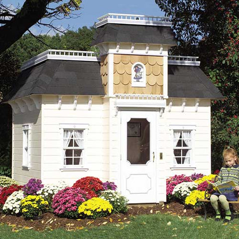 grace playhouse shown in white with black shingles and cedar shake tower