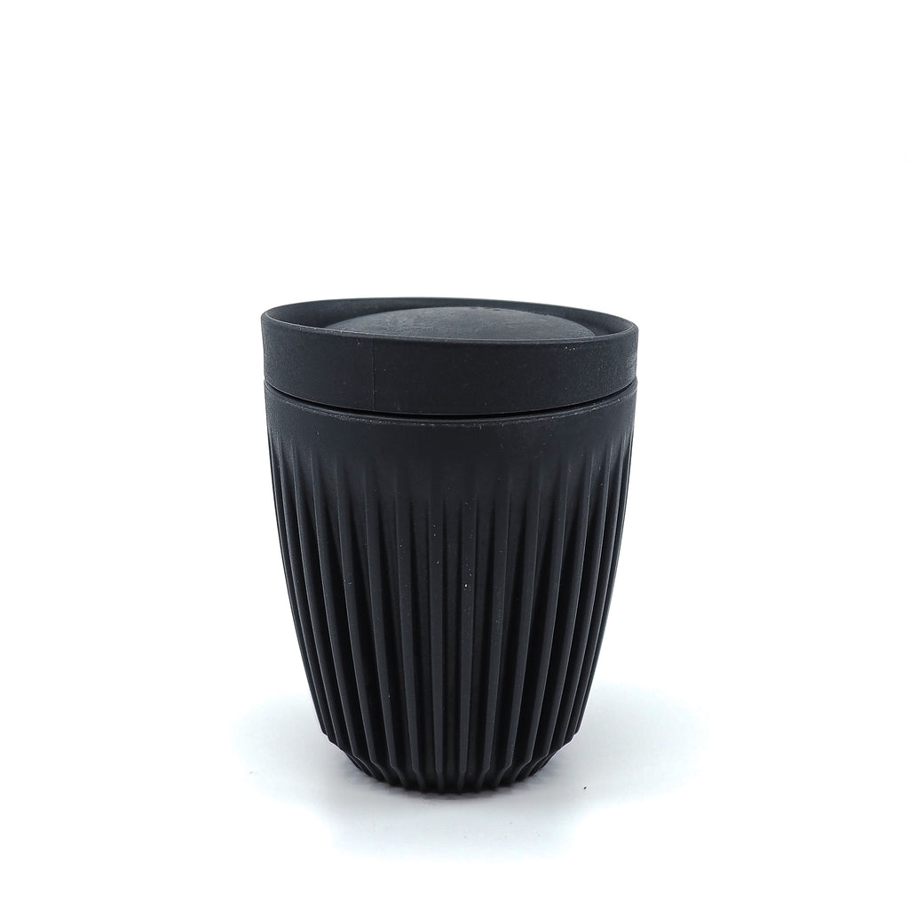 Black Huskee coffee cup reusable, made of coffee husks