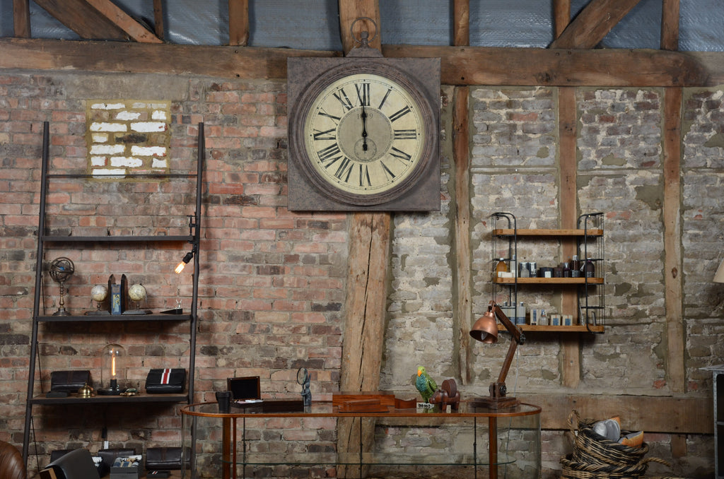 View of the original brickwork at the rear of the 450 year barn showroom , with vintage display cabinet in front.