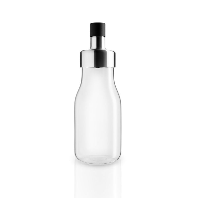empty glass shaker, with cap oon. silver stainless steel top, black silicone cap.