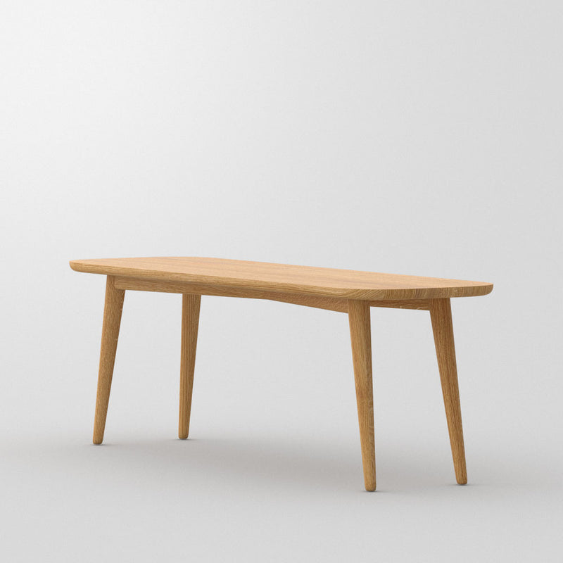 amber oak bench - backless-  with rounded edges, cone legs. side view