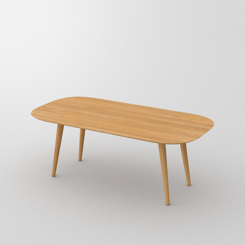 amber oak dining table with rounded edges, cone legs