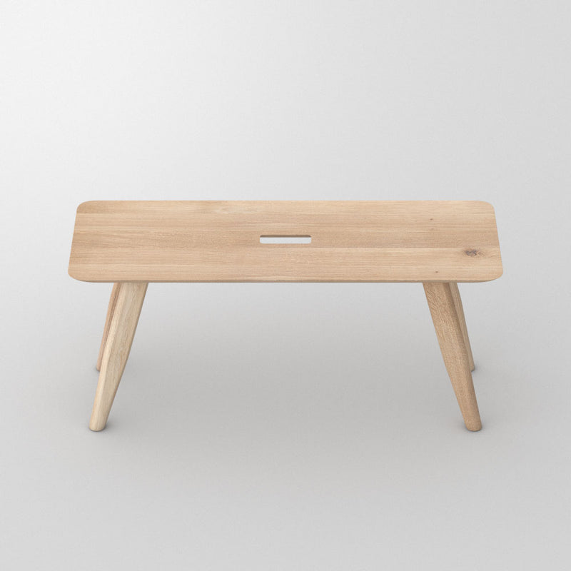 Oak - in light oil- atlas bench, angled legs with a hand hole in centre for moving around.