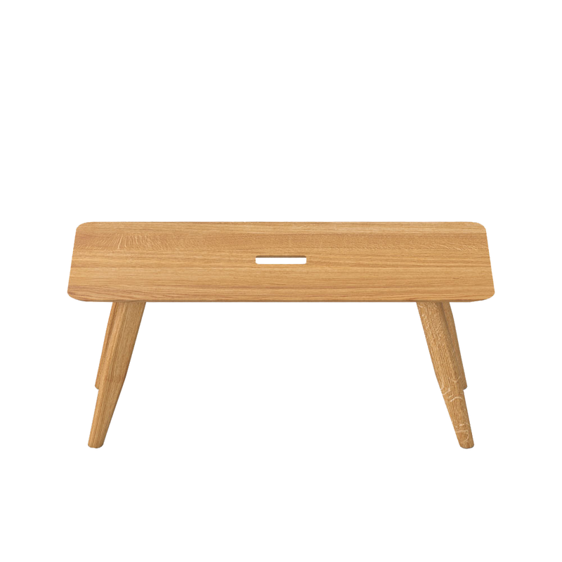 Oak atlas bench, angles legs with a hand hole in centre for moving around.