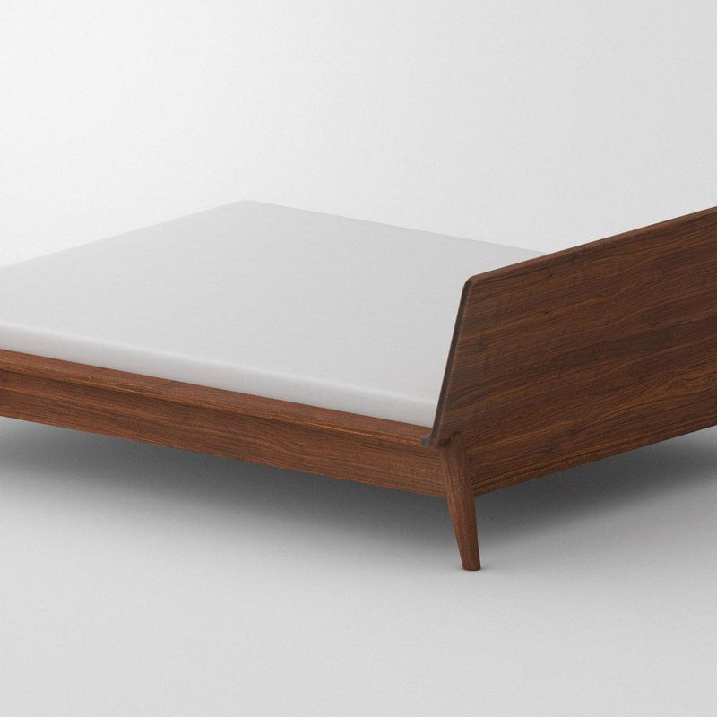 Back view of solid walnut double bed with white mattress