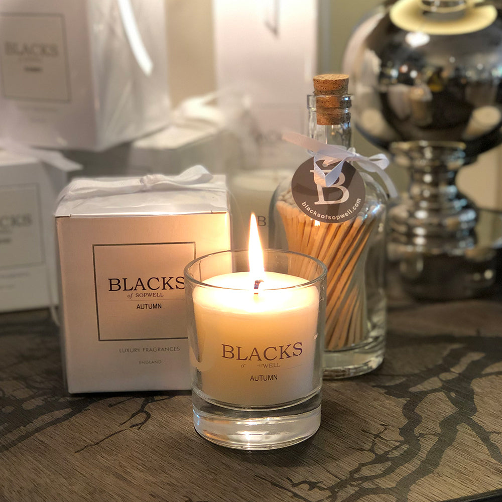 Blacks Autumn Candle out of box and shown next to a boxed candle