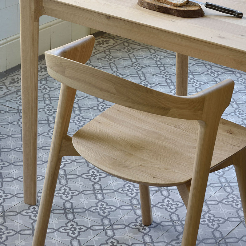 solid oak chair shown under table
