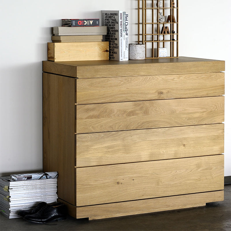 styled on the bedroom, chest has a flat solid wood top.