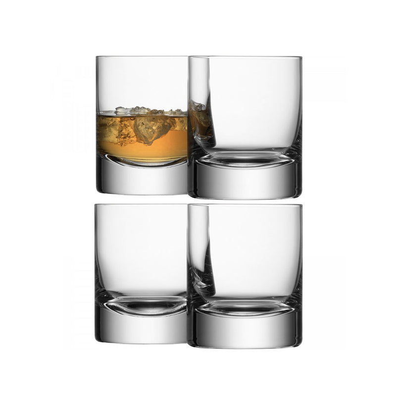 Set of four glass tumblers one with whiskey and ice
