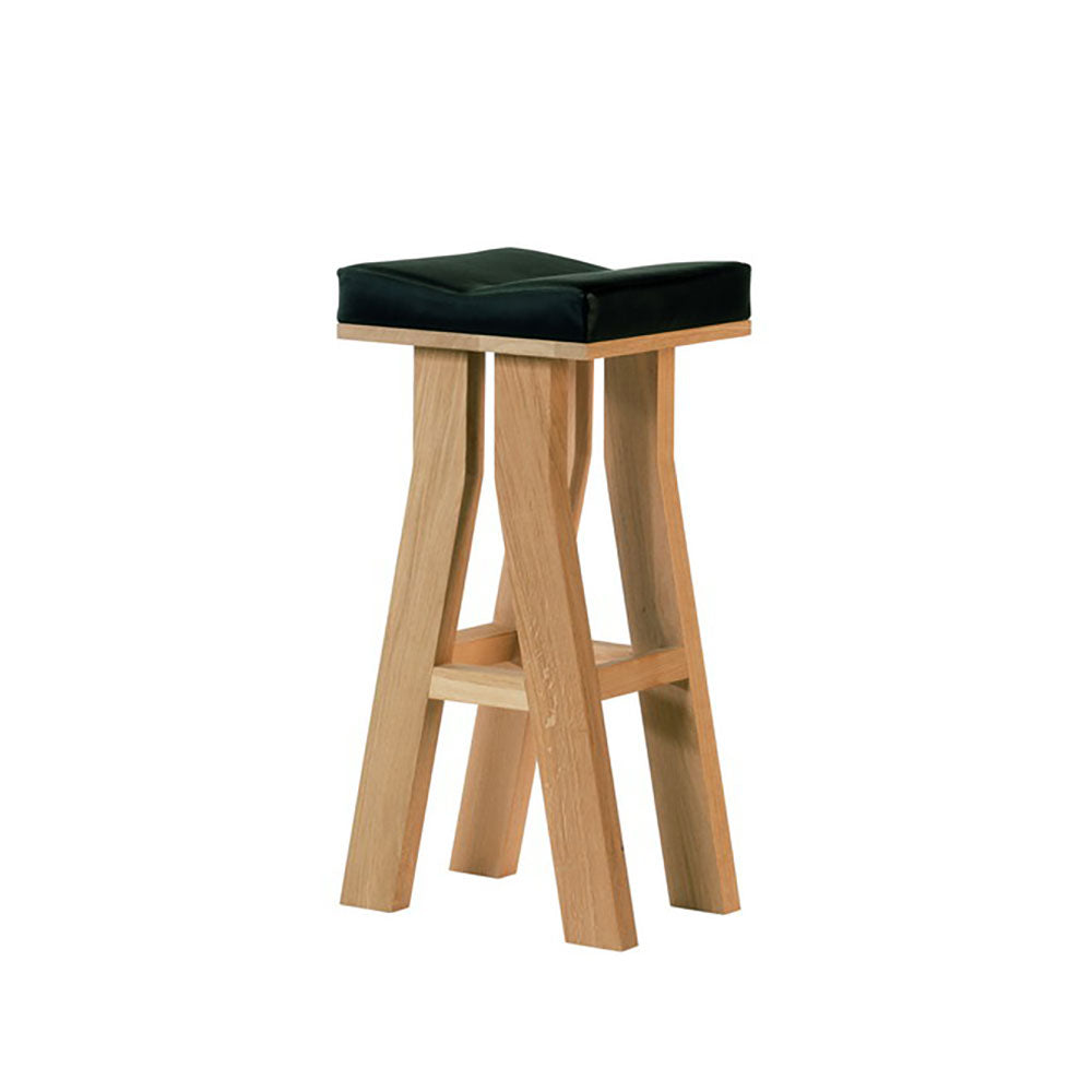 Oak four legged barstool, thick wood with leather seat top.