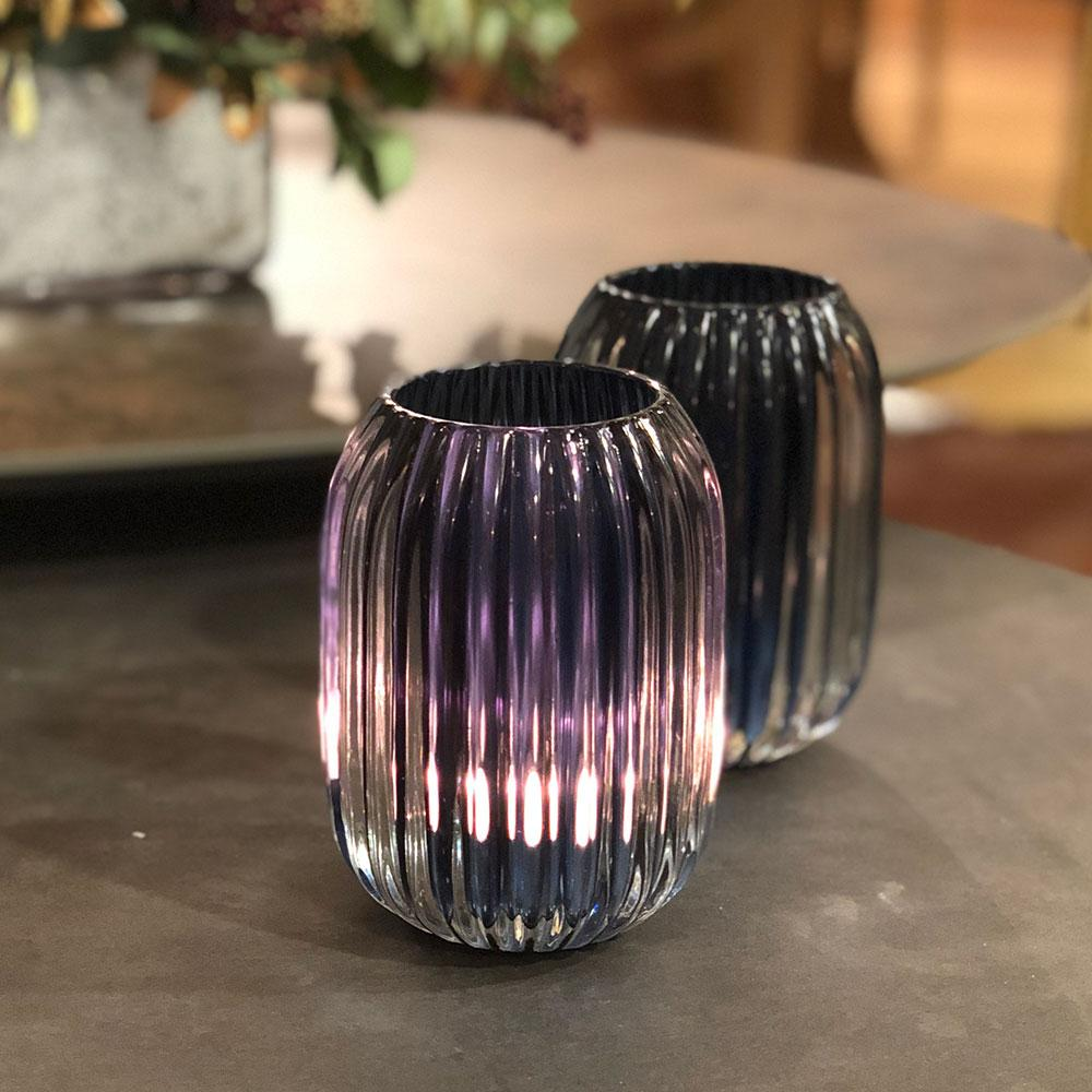 heavy glass ribbed votive holder- with lit tealight glowing through blue glass