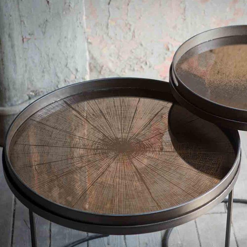 bronze mirrored glass tray with tree trunk slice pattern printed under glass.
