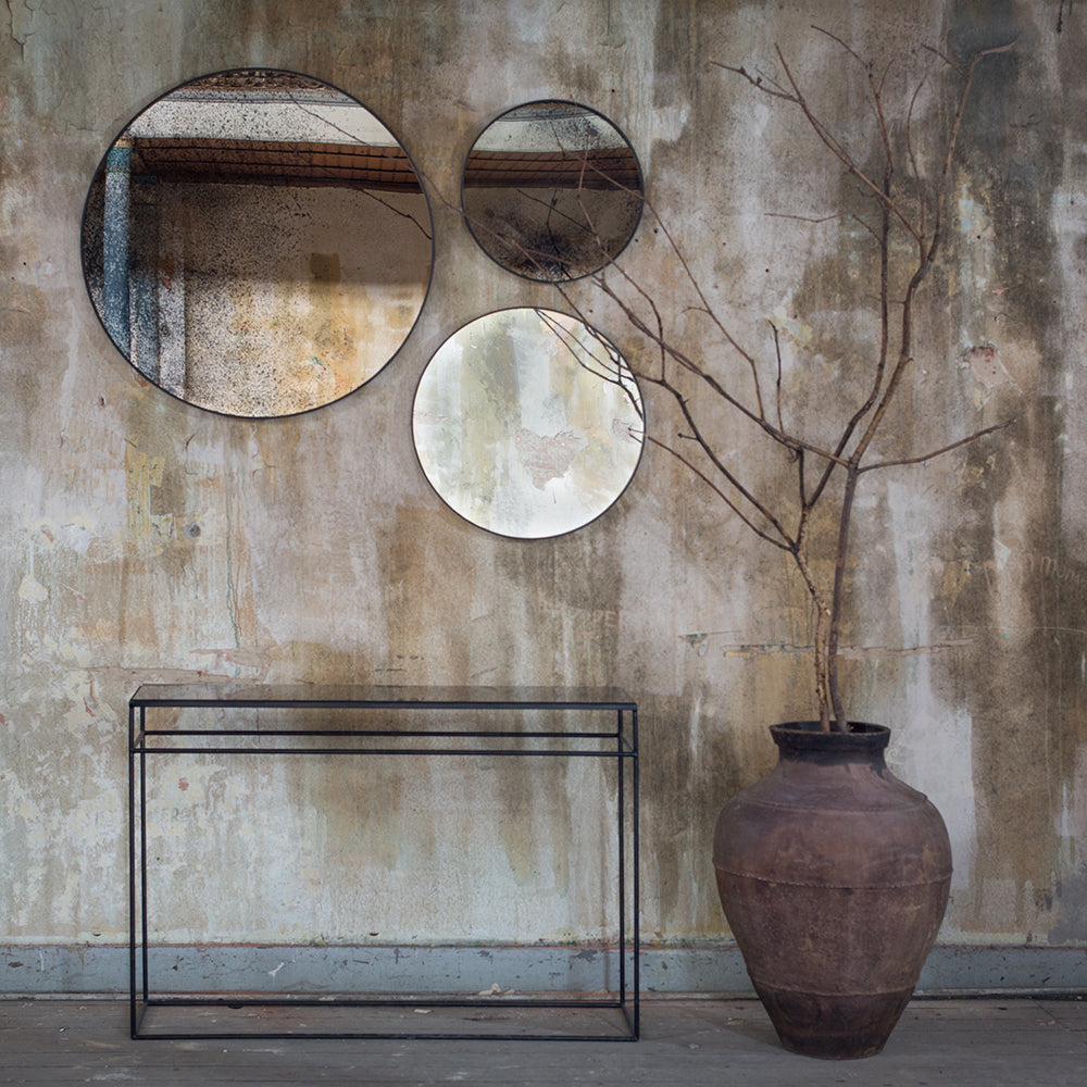 aged glass mirror console shown under aged glass round wall mirrors