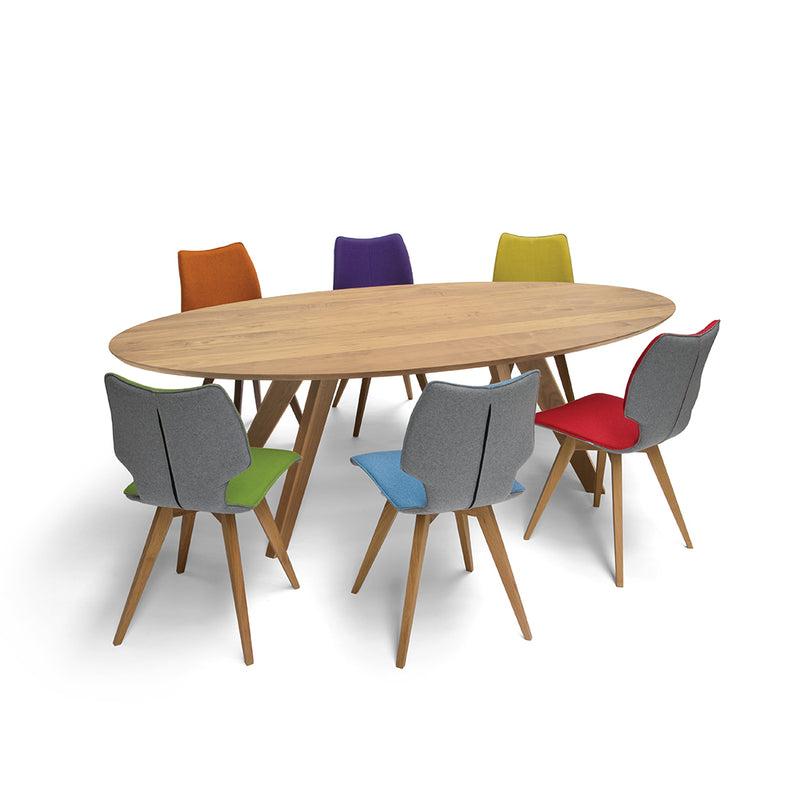 c1 chairs around a dinihg table- grey backs and multi coloured chair fronts; purple orange, green, yellow, blue, red