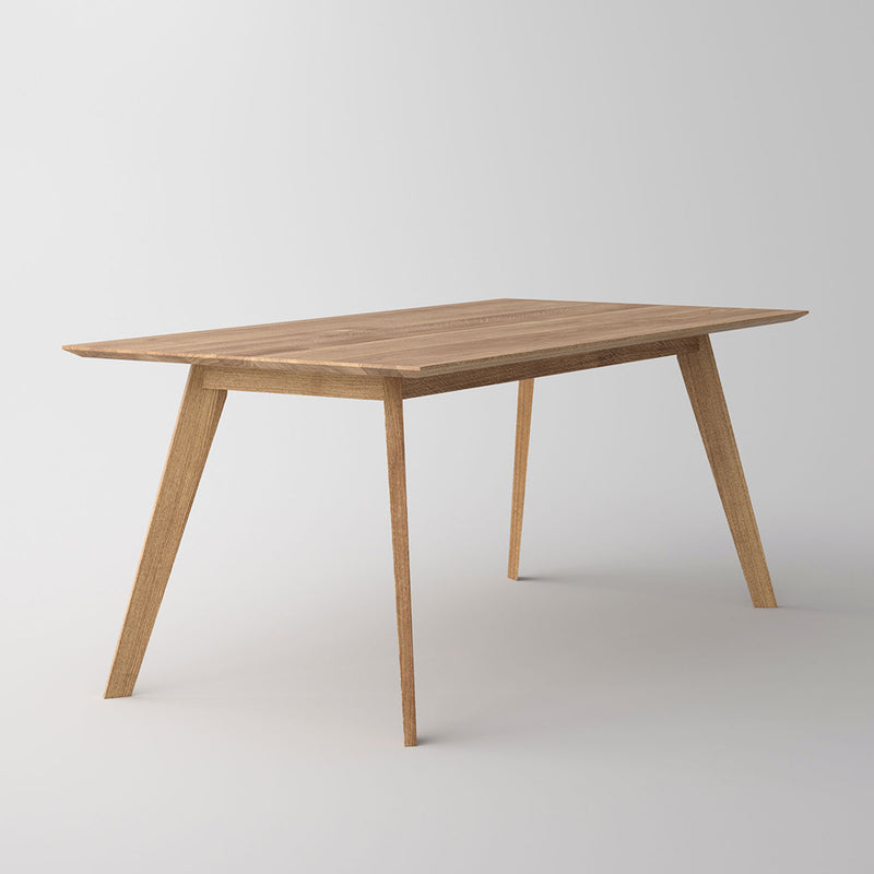 Citie dining table , tapered edge and angled legs in a natural oil finish