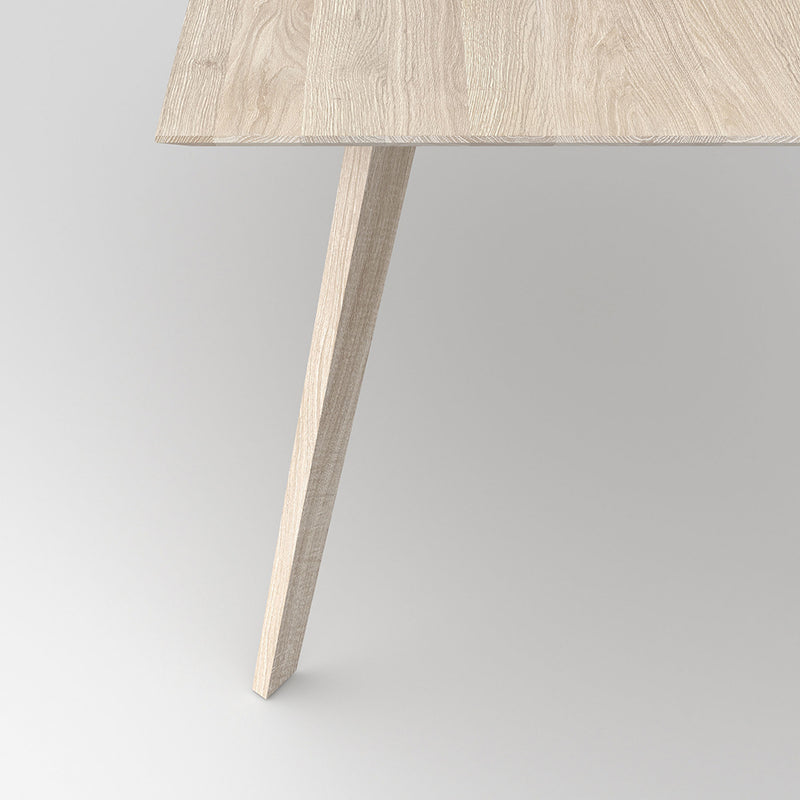 Detail shot of the leg profile on the citie table in white oil finish