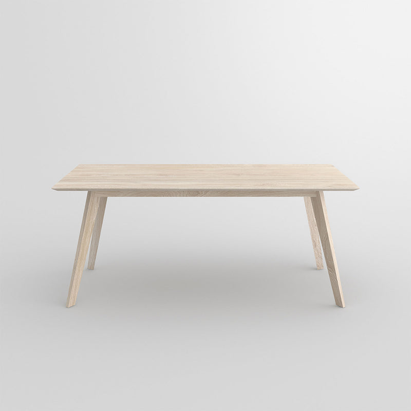 citie oak dining table side view with a white oil finish
