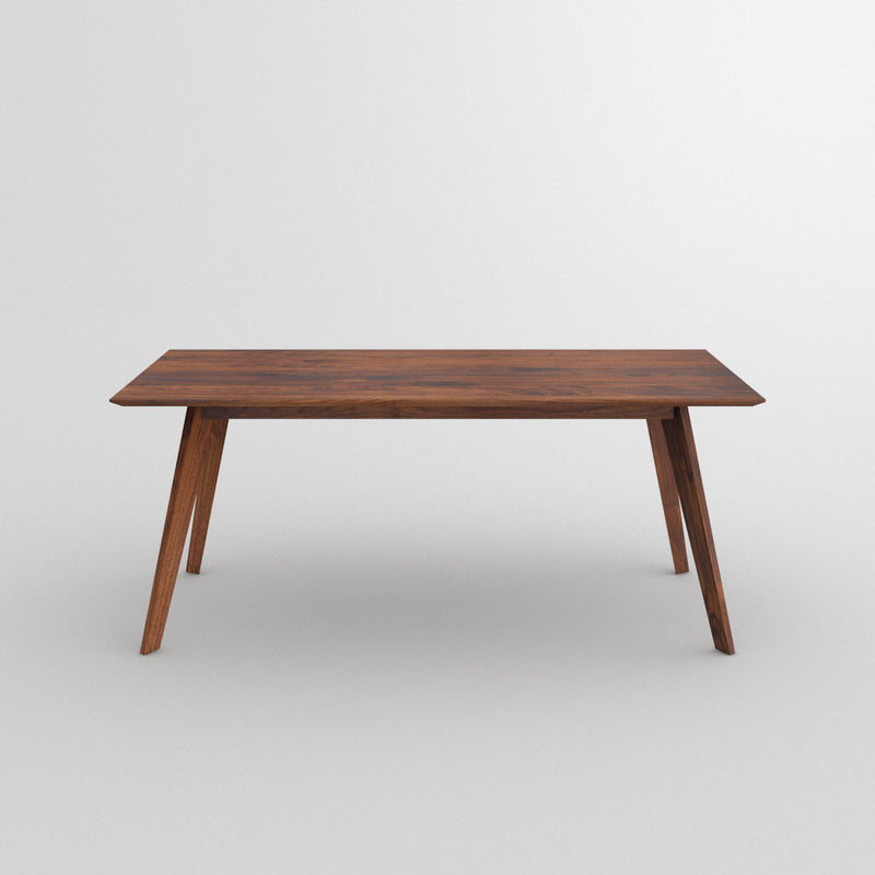 Citie bespoke dining table shown in walnut