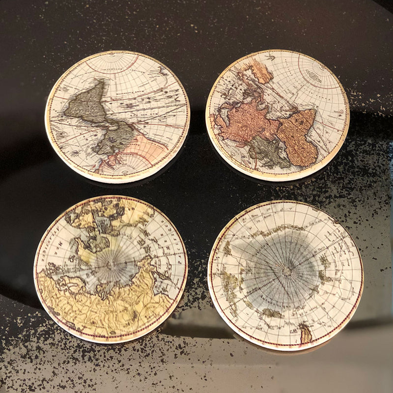 four round coasters each with a different image of an old map, sepia colours